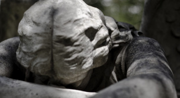 Statue of an angel grieving in a cemetery in Houston, Texas.